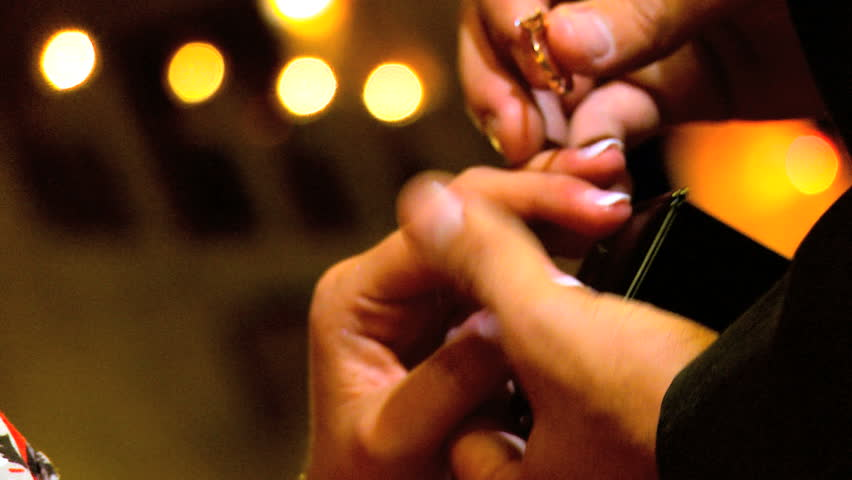 Diamond ring being placed on female finger during marriage proposal in close-up - HD stock footage clip
