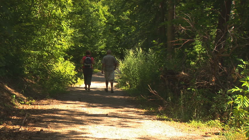 Couple Walking Down a Path - HD stock footage clip