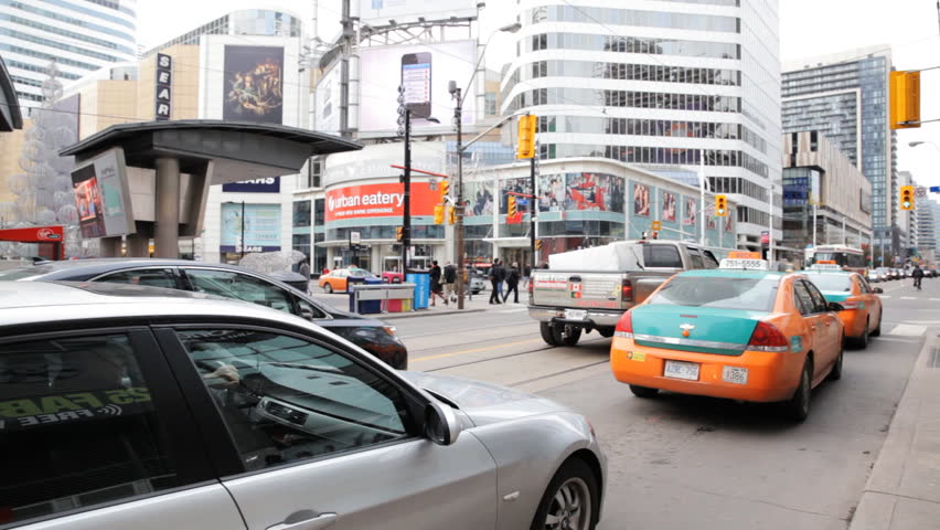 TORONTO, CANADA DECEMBER 5th 2013: A Toronto Streetcar At Dundas Square Near The Eaton Center Shopping Mall, the centre of shopping in Toronto.