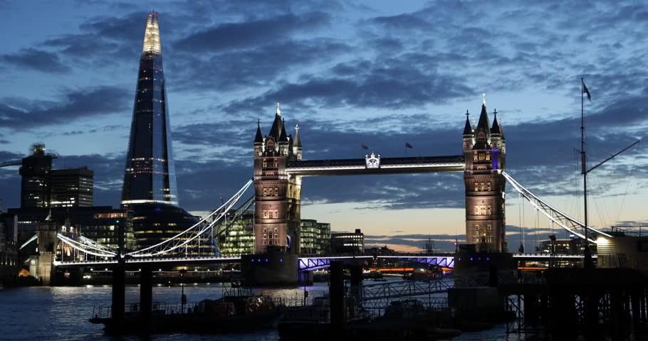 Illuminated Famous Tower Bridge in London Skyline with Shard Skyscraper in Twilight Dusk Light Evening Night Lit ( Ultra High Definition, Ultra HD, UHD, 4K, 2160P, 4096x2160 ) - 4K stock footage clip