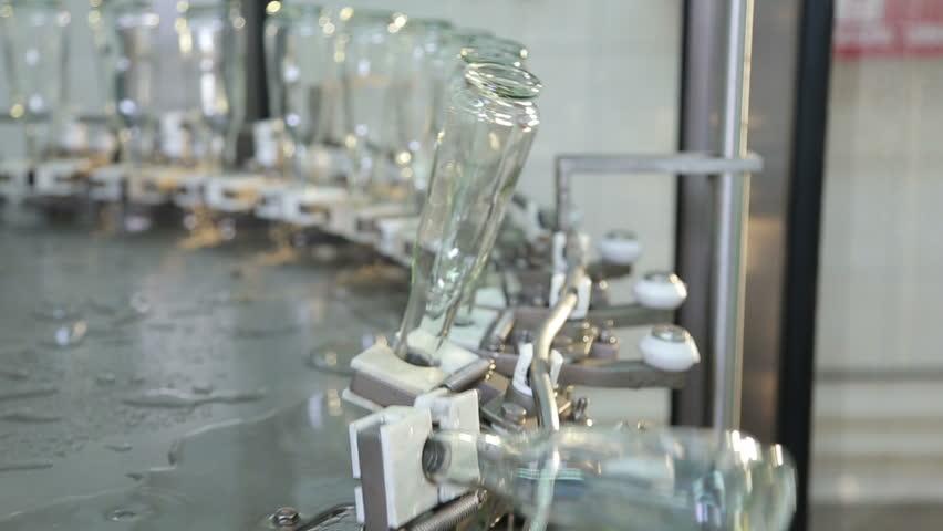 transparent empty bottles on a conveyer - HD stock video clip