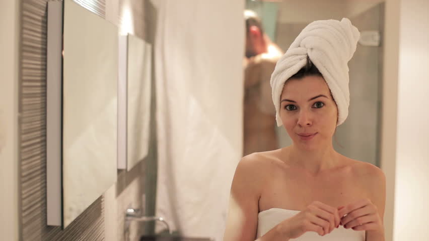 Portrait of beautiful happy woman in the bathroom
