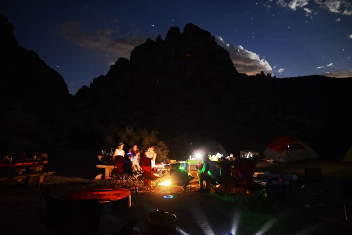 4K Time Lapse of Camping around Bonfire in Desert at Night