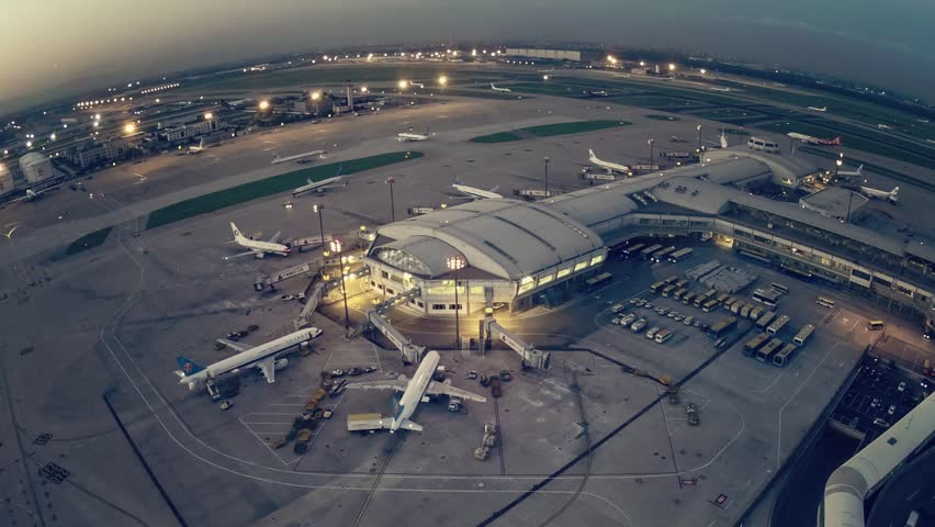 A timelapse clip of airport terminal shot from a control tower at sunset.