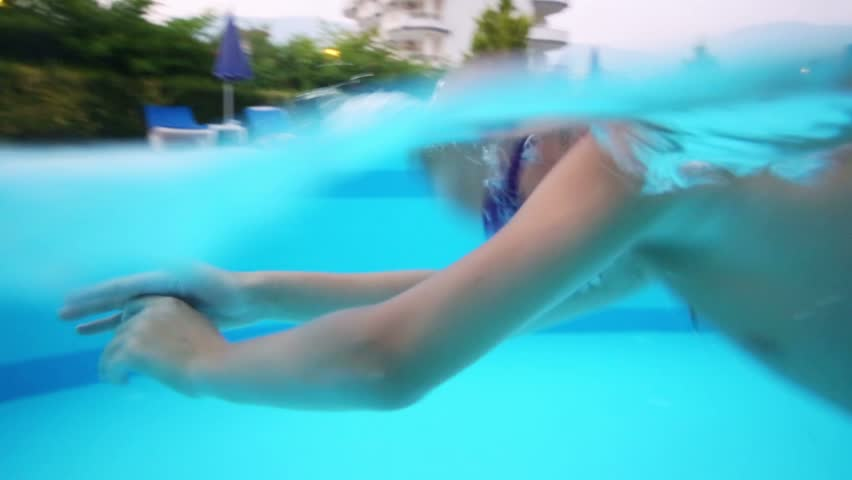 Little boy swims in hotels pool in swimming glasses - HD stock footage clip