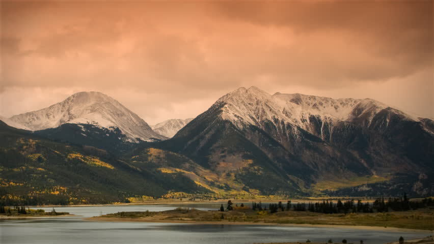 (1118) Autumn Early Snow Storm - Sunrise Timelapse of Mountains and Aspen. Great for themes of nature, travel, wilderness, seasons, weather, mountains, exploration, outdoor recreation, adventure.