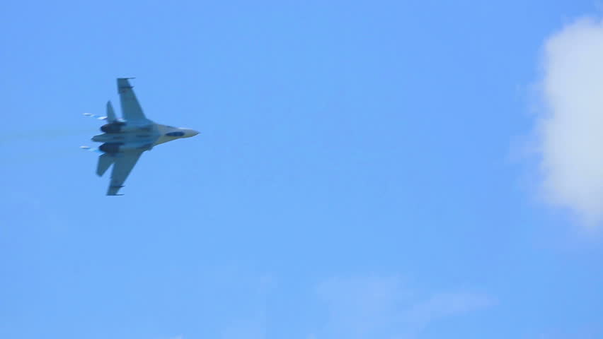 Su-27 Sukhoi jet fighter performing aerobatic flight at the airshow near Novosibirsk.