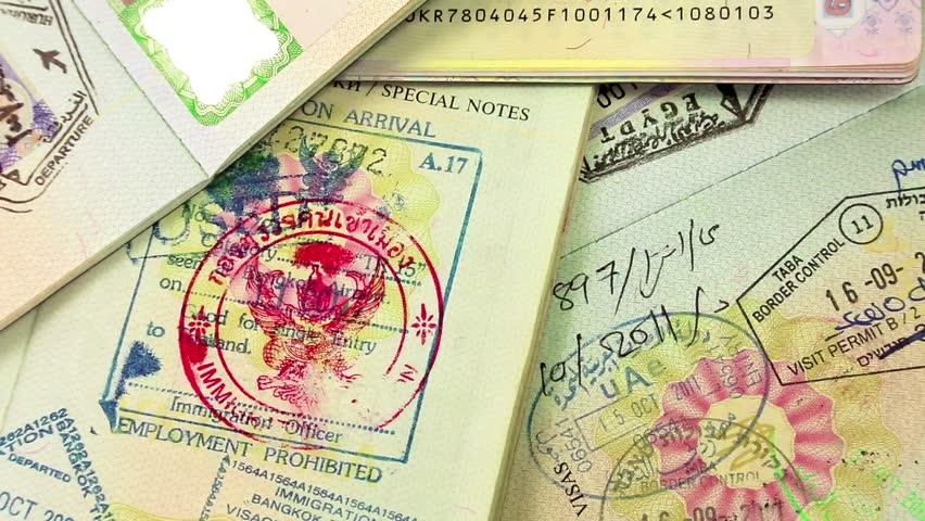 KIEV, UKRAINE, AUGUST 05, 2012: International passports with visas (USA, Egypt, Thailand and Shengen visas)