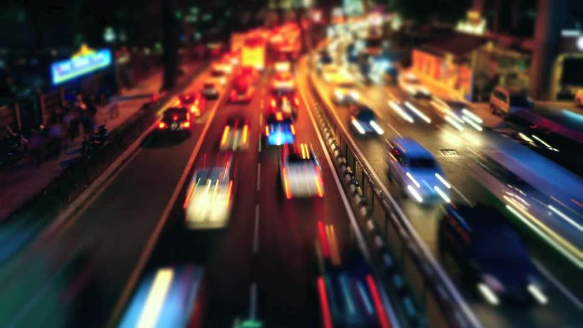 KUALA LUMPUR, MALAYSIA - NOVEMBER 8: Time Lapse of busy traffic at night on a road in Jalan Ampang in Kuala Lumpur, Malaysia on 8 November 2013 - HD stock footage clip