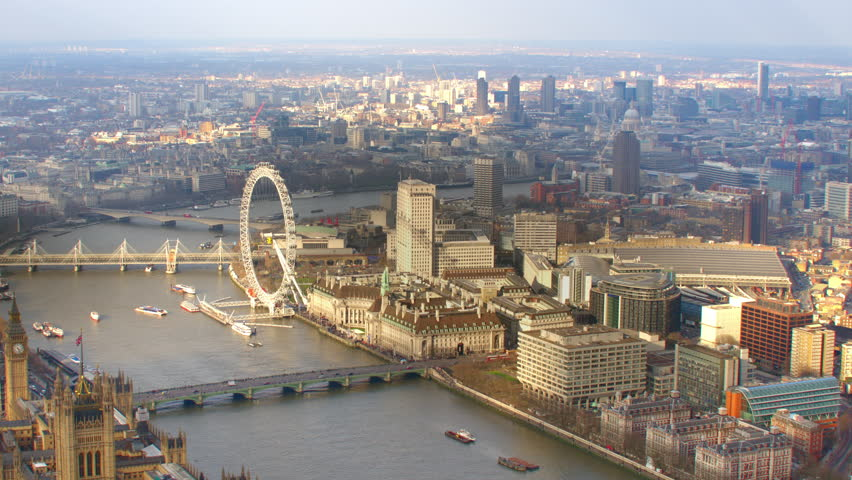 4K Aerial shot of Central London with view of the River Thames, London Eye, Waterloo Station, St Paul's Cathedral