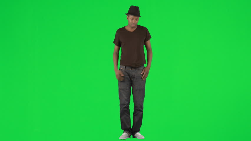 Ethnic young man dancing with a hat footage