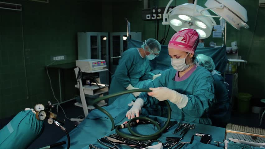 Surgeons Team Performing Operation In Hospital Operating