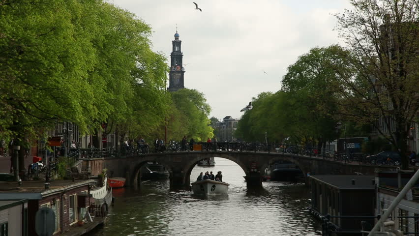 picturesque Amsterdam canal with two boats