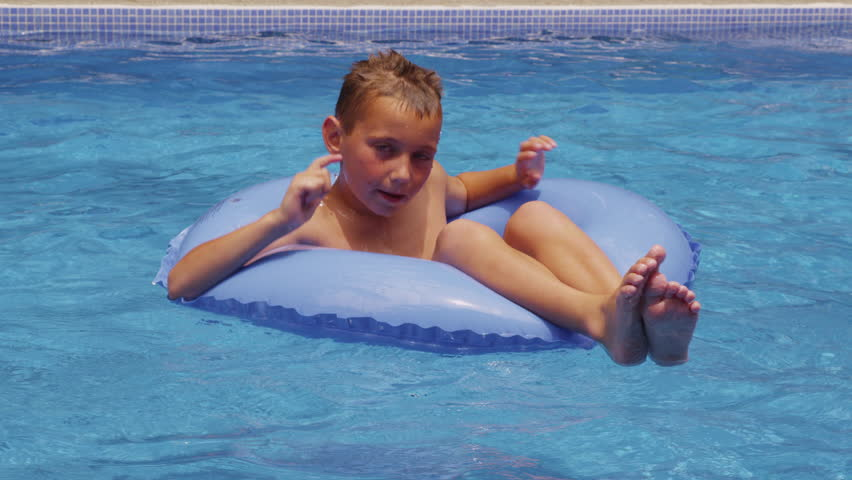 Two Boys In Pool With Inner Tubes Shot On Red Epic For High Quality 4k Uhd Ultra Hd