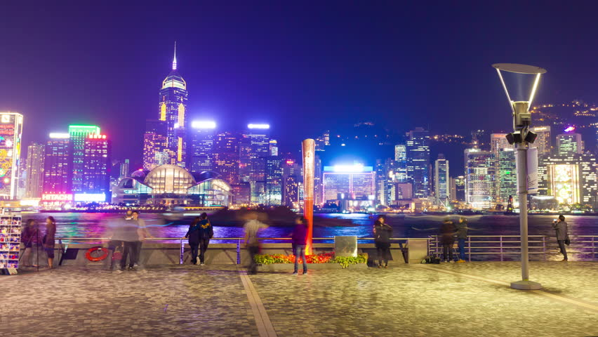 Hong Kong, China - November 25: 4k hyperlapse video of tourists visiting the Tsim Sha Tsui Promenade in Hong Kong on November 25, 2013. It offers a spectacular view of the  Victoria Harbour.