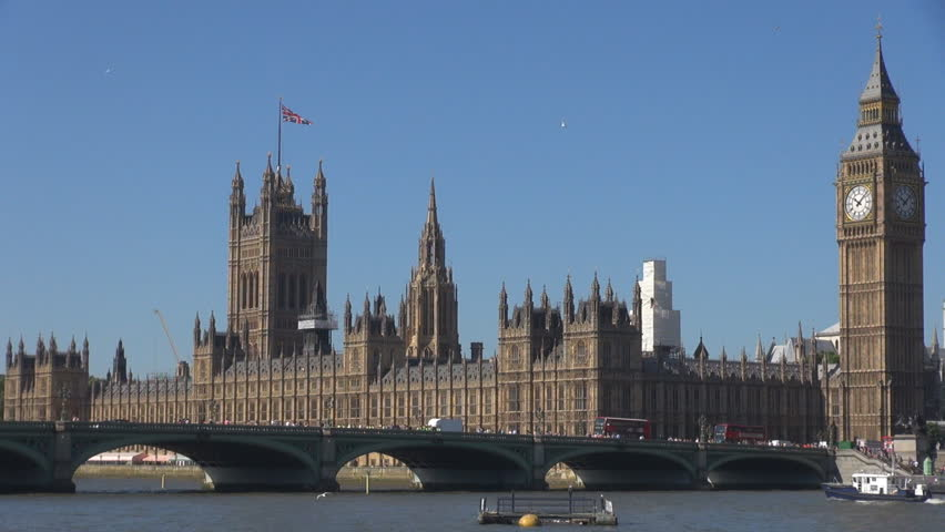 Palace Westminster, Houses Parliament,  Tower Clock,  Big Ben and bridge traffic car over Thames River, London, UK in sunny day