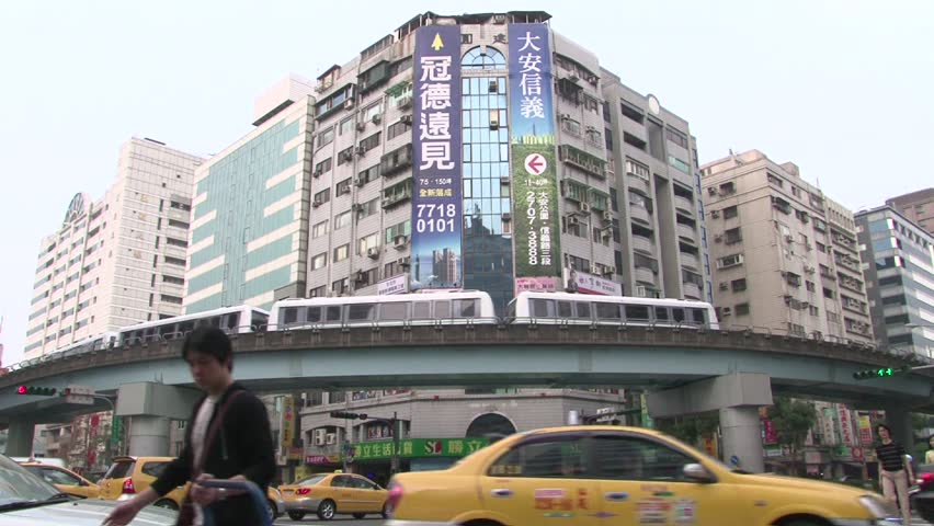 Long shot from taiwan´s traffic street/square. Pedestrians and train. - HD stock video clip