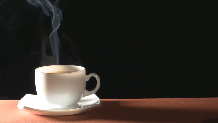 Cup of hot drink with steam over black background  - HD stock video clip