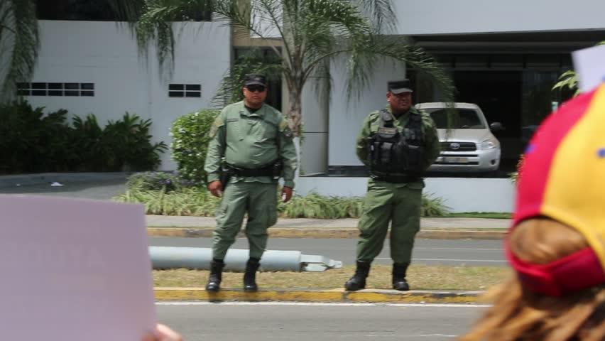 Panama City, Panama, Circa 2013: Panamanian policemen direct traffic near protest of Venezuelans in Panama City, Panama, Circa 2013 - HD stock video clip