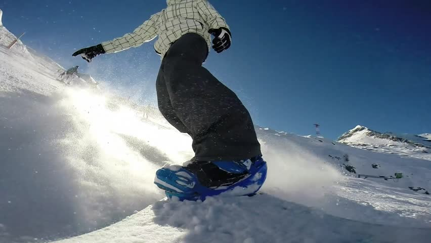 snowboarder on track in alpine mountains pov