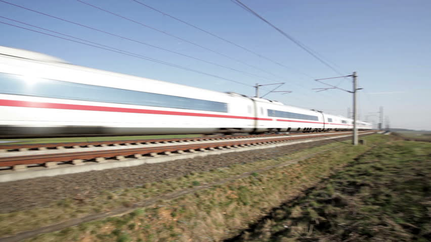 WALLAU, GERMANY -?? MARCH 10: A passing german highspeed train (ICE) on the Frankfurt-Cologne line on March 10, 2014 near Wallau, Germany. The maximum speed of these highspeed trains is around 320km/h