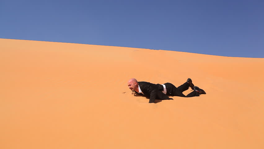 lost and desperate businessman in desert - HD stock footage clip