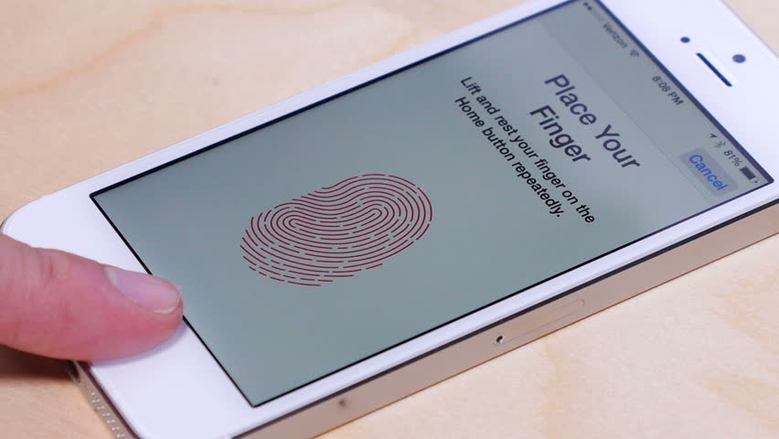 PITTSBURGH, PA - Circa March, 2014: An unidentified person sets up the fingerprint scanner on an Apple iPhone 5S.