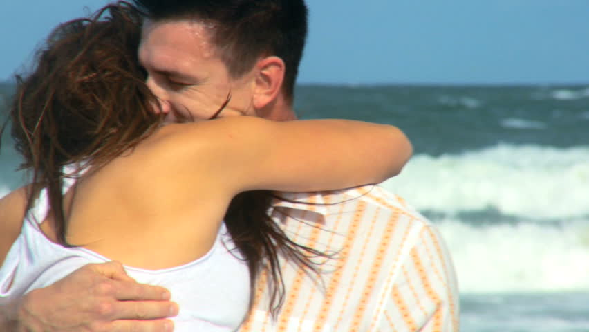 Two young people in love spending time together on the beach 60 FPS - HD stock footage clip