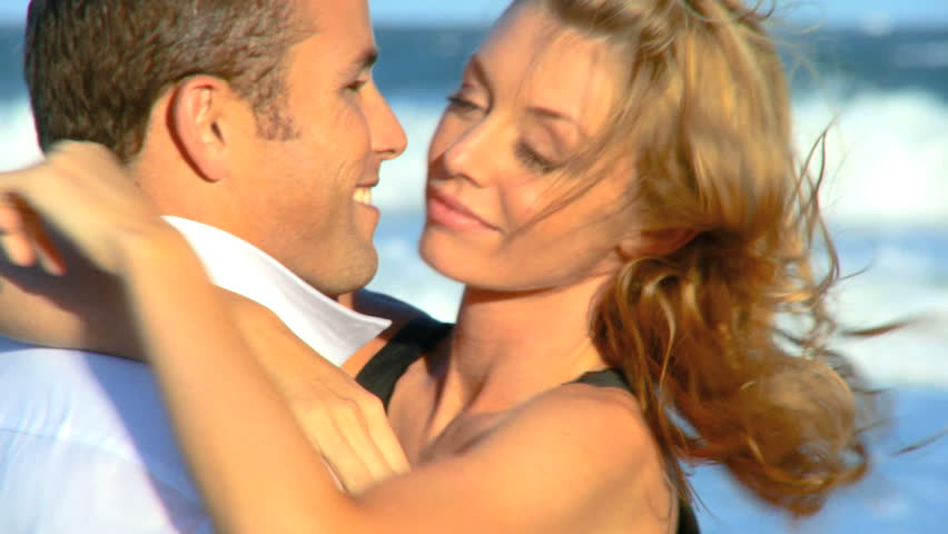 Two young people in love enjoying time on the beach early morning after a social night out 60 FPS  - HD stock footage clip