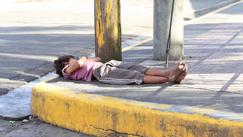 CEBU, PHILIPPINES - MARCH 15, 2014 :  Poverty in Pholippines, a unidentified children sleeping on the street. Nearly one of every three Filipino children aged 4 to 10 is underweight .