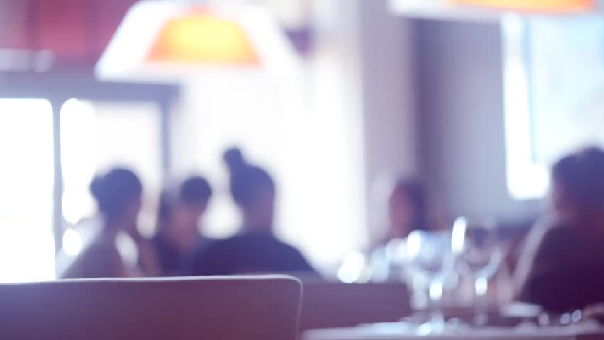 Dinner in a restaurant. Group of people eating and talking. Defocused background. Eating people. Gourmet food - HD stock footage clip
