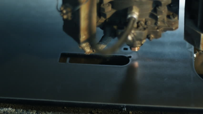 The industrial laser cuts a metal sheet. - HD stock footage clip