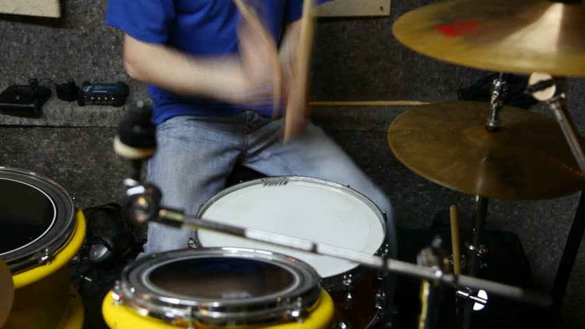 Unidentified drummer playing on drums in studio    Shutterstock HD Video #594742