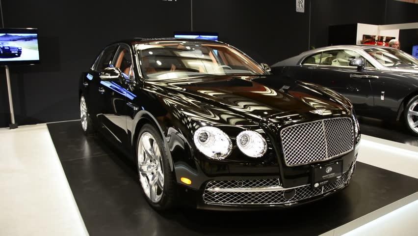 TORONTO,CANADA-FEBRUARY 22, 2014: Bentley display as seen in the Canadian International Auto Show in Toronto. The largest auto show in Canada showcases more than 1000 new cars motorcycles and more.