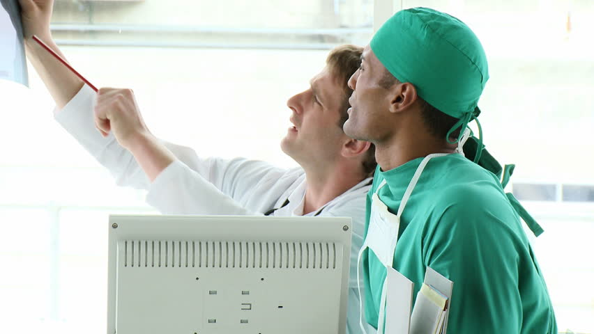 Footage in high definition of medical team examining an x-ray  - HD stock footage clip