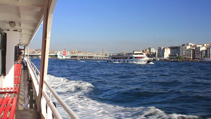ISTANBUL - MAY 22, 2013: TurYol commuter ferries connect Galata Bridge with the Asian suburbs of Uskudar and Kadikoy. Ferryboats are the absolute most enjoyable way to travel in Istanbul, Turkey