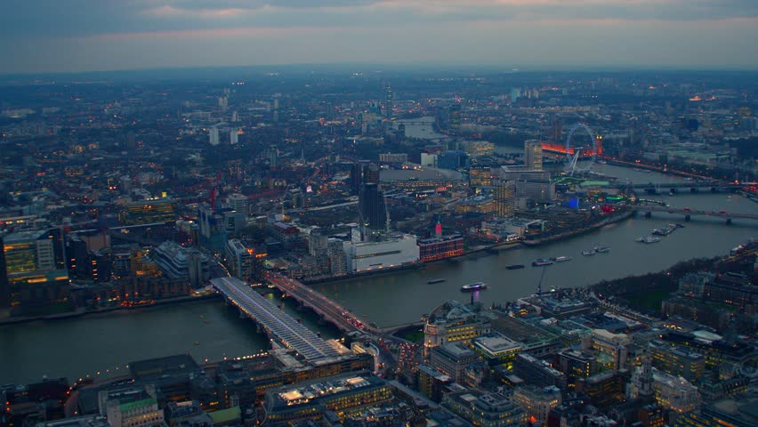 4k aerial shot of central london at night with view of