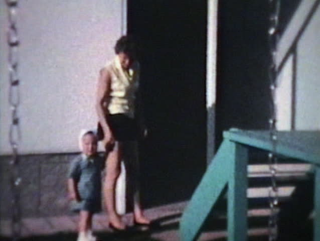 Mom And Little Boy Outside (1963 - Vintage 8mm Film) Stock