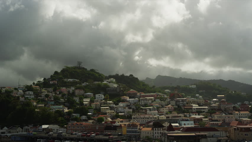 Wide Shot Townscape under cloudy sky / St. Georges, Grenada, Caribbean - HD stock footage clip