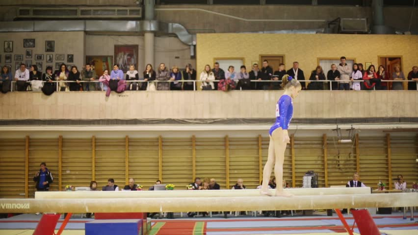 MOSCOW, RUSSIA - DEC 15, 2012: Girl somersaults on boom in Hall Dynamo Stadium at XIX International Gymnastics Tournament for Cup of Voronin.