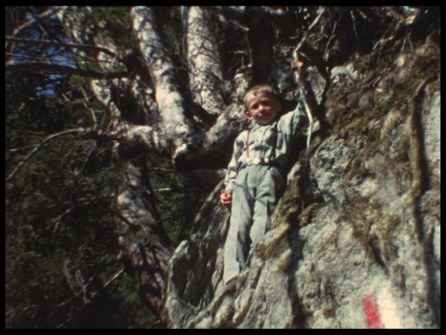 Mother and child resting from mountain trip (vintage 8 mm amateur film) - HD stock video clip