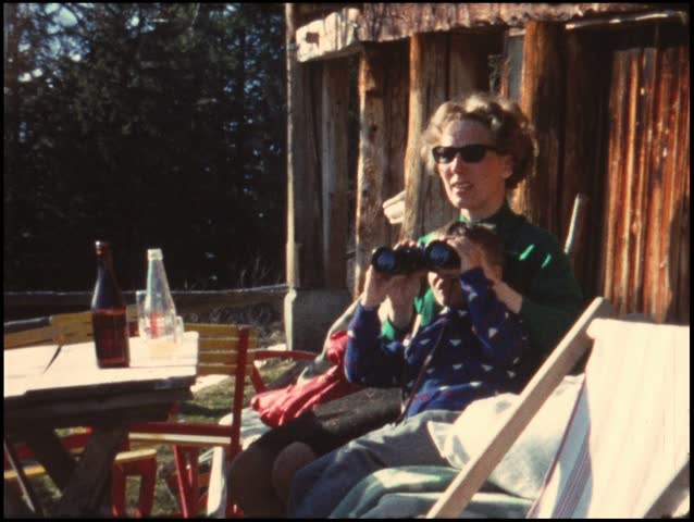 Mother and child resting from mountain trip (vintage 8 mm amateur film) - HD stock footage clip