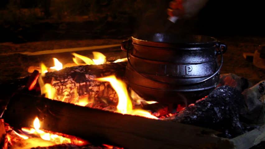 Big pan over the coals.