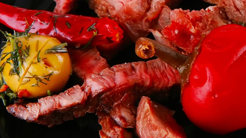 roast meat on black dish with red hot pepper and olives 1920x1080 intro motion slow hidef hd