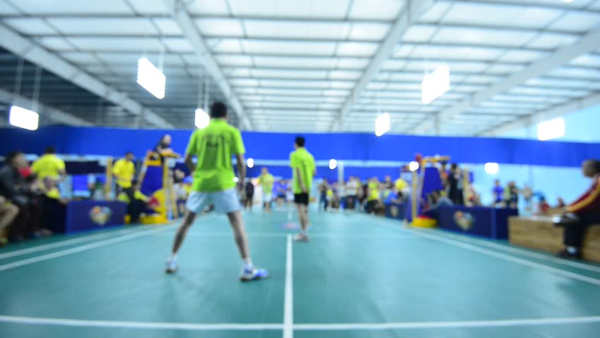 Badminton courts with players competing in indoor stock for Indoor badminton court height