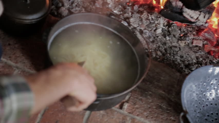 man making sure pasta is well done - HD stock footage clip