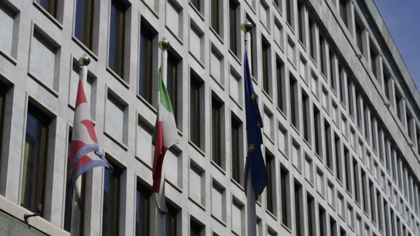 Flags waving at the wind in front of the building