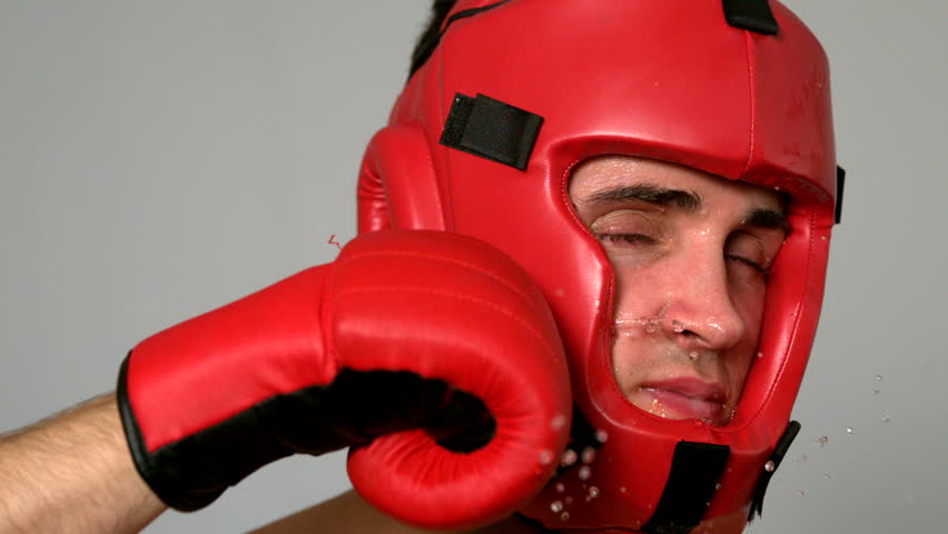 Tough boxer taking a punch to the face in slow motion