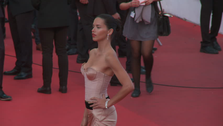 "CANNES, FRANCE - MAY 2014: Supermodel Adriana Lima wearing a champagne colored Alexandre Vauthier Couture gown on the red carpet at the premiere of ""The Homesman"" at the 67th Cannes Film Festival."