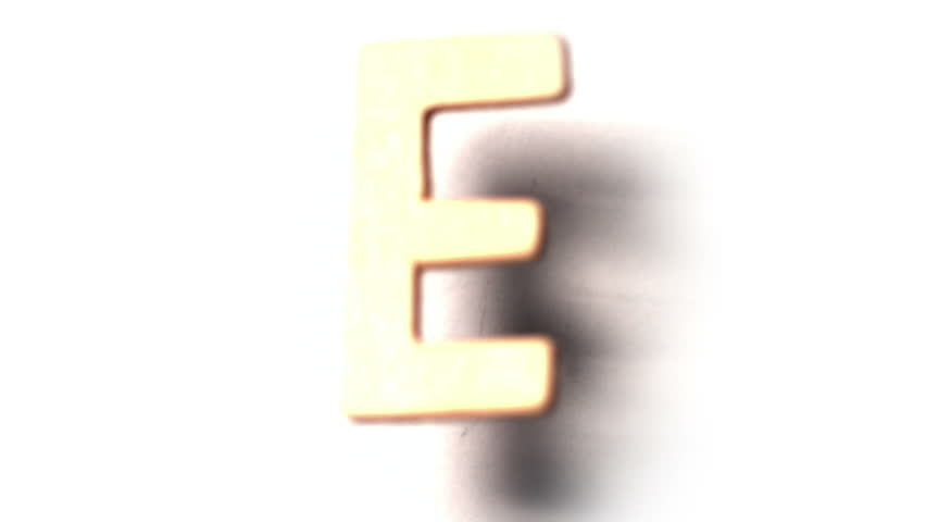 The letter e rising on white background in slow motion - HD stock footage clip